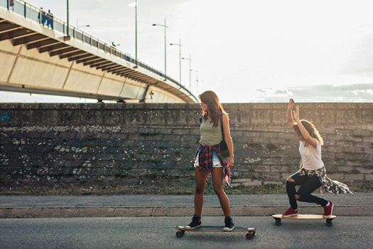 two girls skateboarding